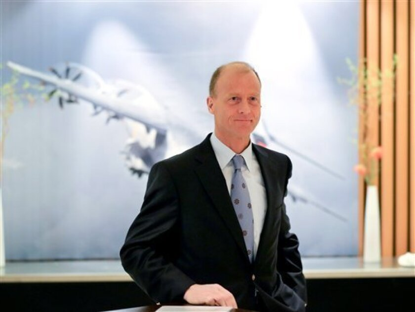 CEO of EADS Tom Enders poses for the media during a balance press conference in Berlin, Germany, Wednesday, Feb. 27, 2013. Airbus parent company EADS NV posted a 47 percent drop in fourth-quarter net profit after taking costly charges at its helicopter and defense electronics divisions. The aerospa