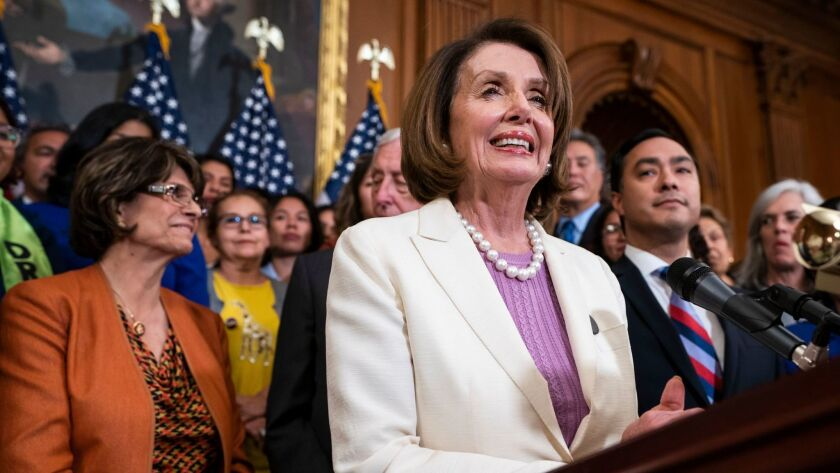 Speaker of the House Nancy Pelosi, along with other Democratic representatives, speaks to the media about the American Dream and Promise Act on Tuesday.