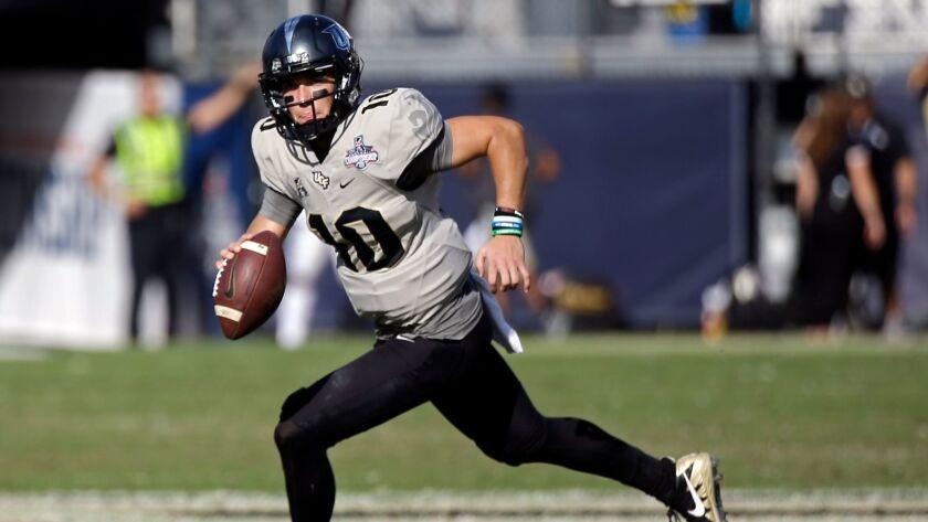 Central Florida quarterback McKenzie Milton scrambles during the second half of the American Athleti