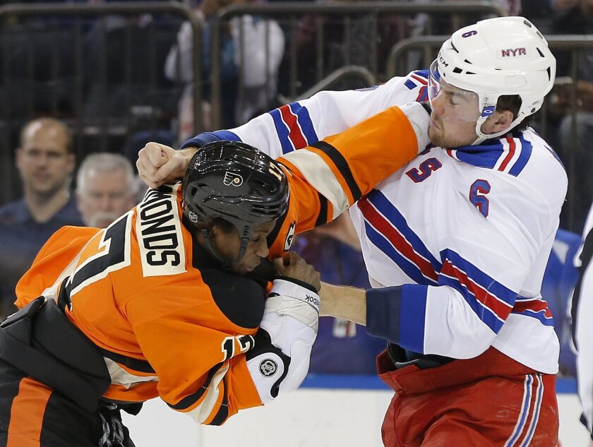 Philadelphia Flyers right wing Wayne Simmonds (17) fights with New York Rangers defenseman Dylan McIlrath (6) during the first period of an NHL hockey game, Sunday, Feb. 14, 2016, in New York. (AP Photo/Julie Jacobson)