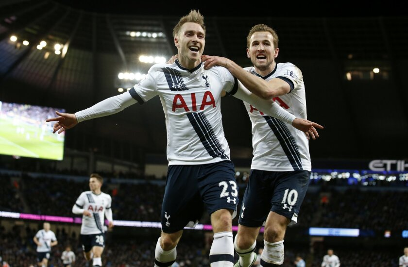 Tottenham's Christian Eriksen, left, celebrates  with Harry Kane after scoring his side's second goal during the English Premier League soccer match between Manchester City and Tottenham Hotspur's at the Etihad Stadium in Manchester, England, Sunday Feb. 14, 2016. (AP Photo/Jon Super)