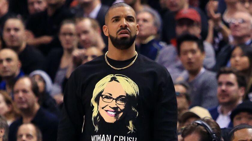 Drake watches his beloved Toronto Raptors take on the Golden State Warriors on Nov. 16.