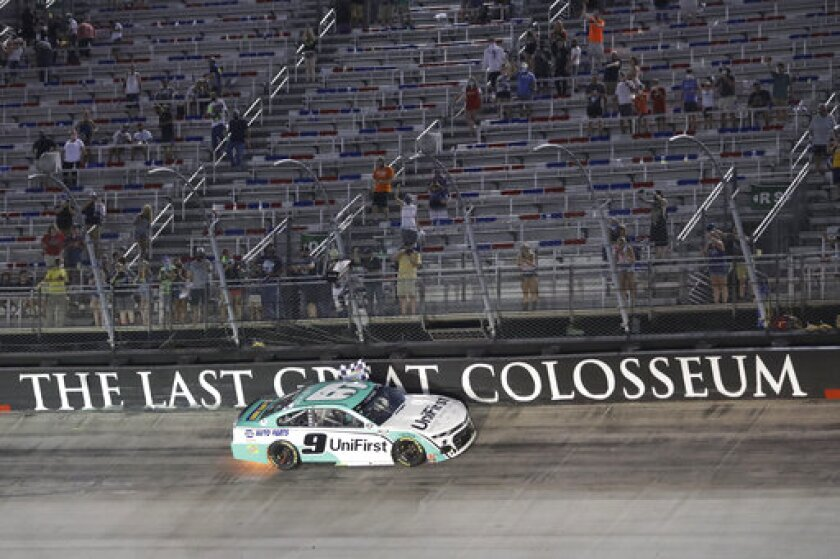 Chase Elliott celebrates does a victory lap after winning a NASCAR All-Star auto race at Bristol Motor Speedway in Bristol, Tenn, Wednesday, July 15, 2020. (AP Photo/Mark Humphrey)