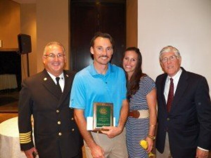 Nick Brandow receives the David B. Dewey Firefighter of the Year Award. L-R: Fire Chief Tony Michel, Engineer Nick Brandow, Leslie Brandow, and Fire District Board President James Ashcraft.