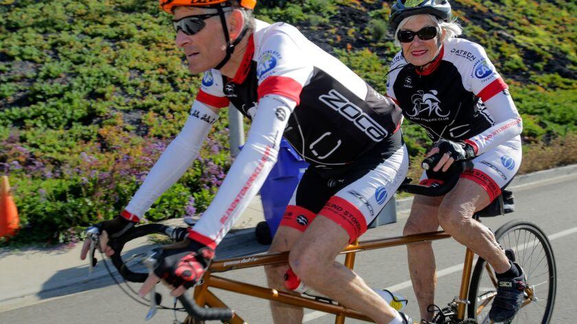 Dorothy Deans riding behind partner Paul Dickstein in Solana Beach Friday. photo by Bill Wechter