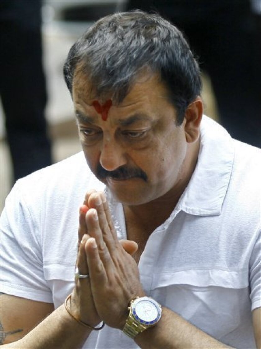 FILE- In this March 28, 2013 file photo, Indian Bollywood actor Sanjay Dutt, gestures during a press conference at his residence in Mumbai, India. Dutt has appealed to India's Supreme Court to give him some more time before he begins a prison sentence for a 1993 weapons conviction linked to a deadl