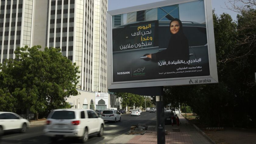 A billboard in Jidda, Saudi Arabia, for Japanese automaker Nissan shows a woman about to get into a car on the day women were legally allowed to drive in Saudi Arabia on June 24.