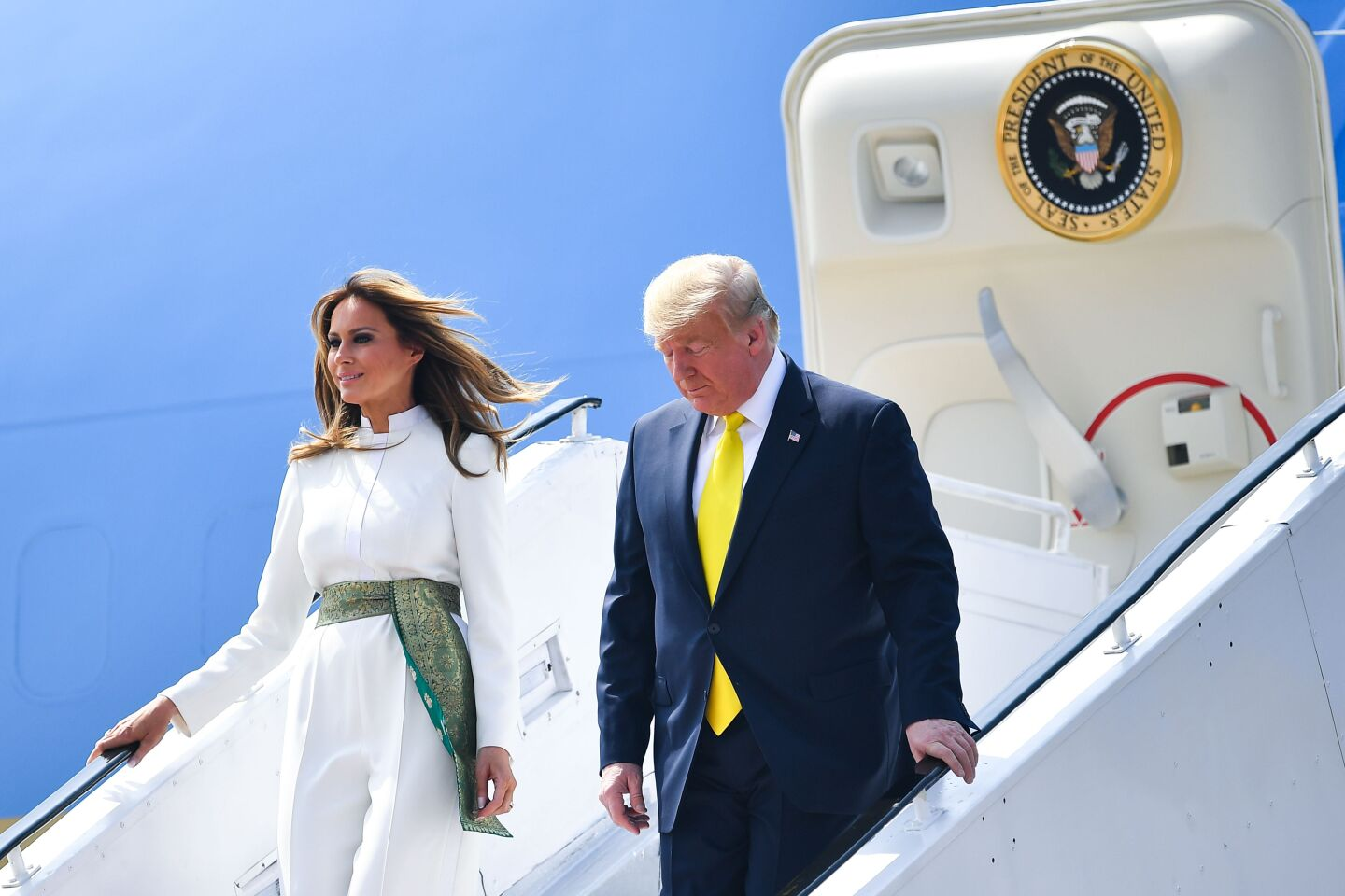US President Donald Trump and First Lady Melania Trump disembark from Air Force One at Sardar Vallabhbhai Patel International Airport in Ahmedabad on February 24, 2020. (Photo by MANDEL NGAN / AFP) (Photo by MANDEL NGAN/AFP via Getty Images)
