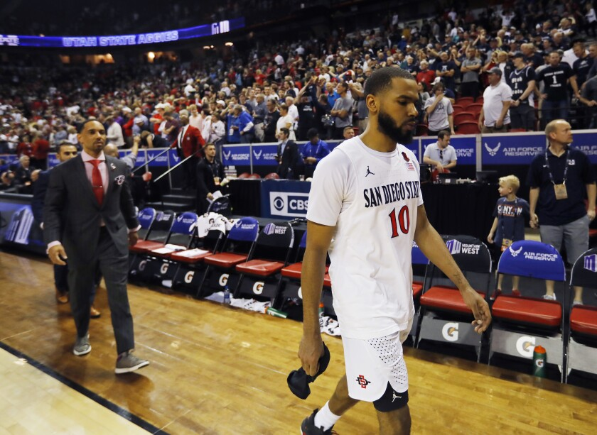 San Diego State's KJ Feagin walks off the court after a loss to Utah State in the Mountain West Conference tournament final. Now the Aztecs have nearly two weeks before the NCAA Tournament.