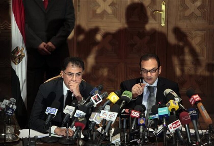 Egyptian investigative judges Sameh Abu Zeid, right, and Ashraf el-Ashmawi, who are investigating the case of foreign funding of NGOs, talk during a press conference at the Ministry of Justice in Cairo, Egypt, Wednesday, Feb. 8, 2012. 43 people including 19 Americans face trials over illegally operating in Egypt and receiving funds from abroad without permission from Egyptian authorities for their human rights and pro-democracy groups. Egypt charges that they fund and support anti-government protests. The groups deny that. (AP Photo/Amr Nabil)