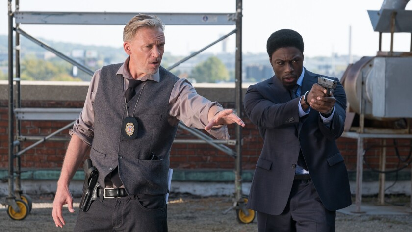 "(L-R) - Callum Keith Rennie as ""Halloran"" and Cle Bennett as ""Det. Keith"" in a scene from the movie"