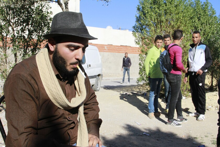 Former Islamic State volunteer Ibrahim Doghri smokes a cigarette in his neighborhood of Mhamdiya near Tunis, Tunisia, on Dec. 5 after his return from Syria, where Islamic State has taken a hard line against smoking.