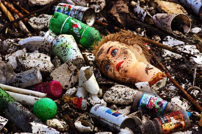 Plastic debris, washed off the city streets of Los Angeles, gathers at the mouth of the Los Angeles River.