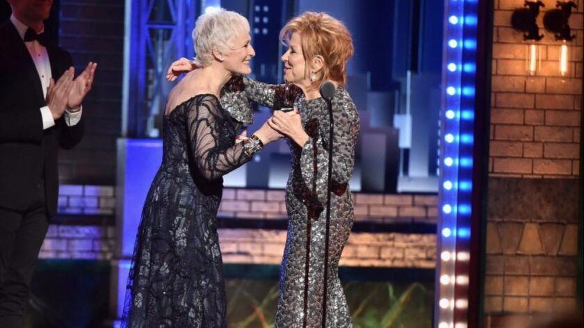 Bette Midler, right, accepts her Tony Award from presenter Glenn Close.