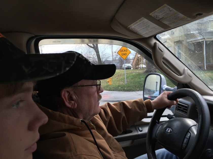Bruce Goacher, right, drives his tow truck in Davenport, Iowa, with his son, Alan. He is a strong supporter of Donald Trump.