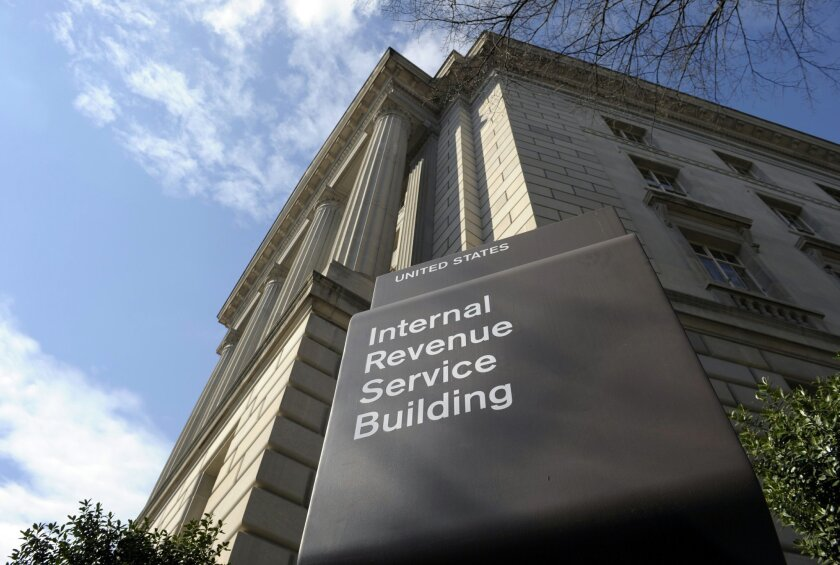"""This photo taken March 22, 2013 shows the exterior of the Internal Revenue Service building in Washington. The IRS has taken """"significant actions"""" to stop agents from targeting political groups based on their names and policy positions, according to a report issued Thursday by the government watchdog who disclosed the inappropriate activity two years ago. (AP Photo/Susan Walsh)"""