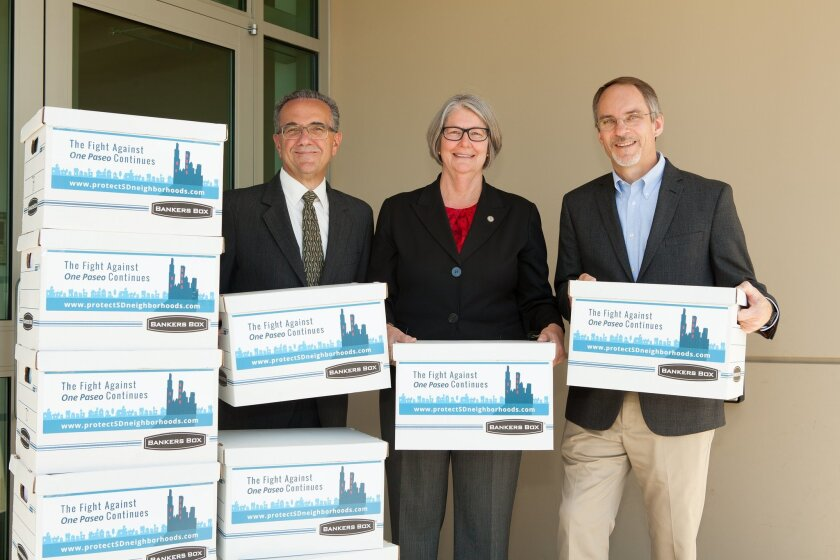 Joe LaCava, chair of the San Diego Community Planners Committee, San Diego City Council President Sherri Lightner and Ken Farinsky of What Price Main Street deliver referendum signatures.