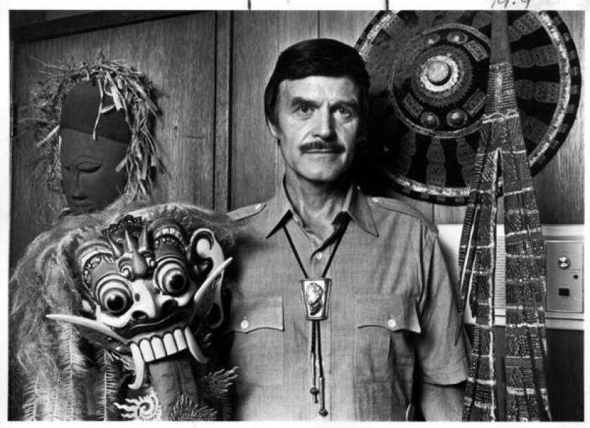 In this undated photo, John Goddard, a lifelong adventurer and explorer, shows off some of the items he collected on his global travels.