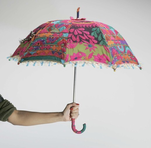 Umbrellas could be thought of as the ultimate accessory. Because they come in all colors and designs, they can easily accent an outfit and keep you dry or shield you from the sun. Pictured here is an embellished umbrella from the Little India area of Artesia.
