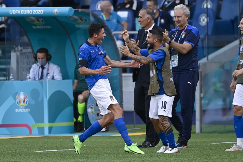 Italy's Matteo Pessina, left, celebrates with Lorenzo Insigne after scoring his side's opening goal during the Euro 2020 soccer championship group A match between Italy and Wales, at the Rome Olympic stadium, Sunday, June 20, 2021. (Riccardo Antimiani, Pool via AP)