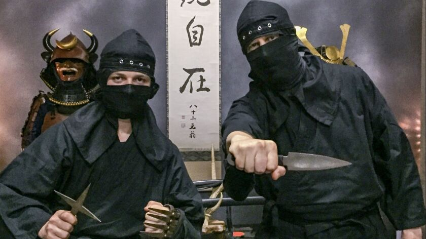 Andrew Bender, right, and his nephew Matthew Cohn posing during a Hands-on Ninja Experience in Tokyo.