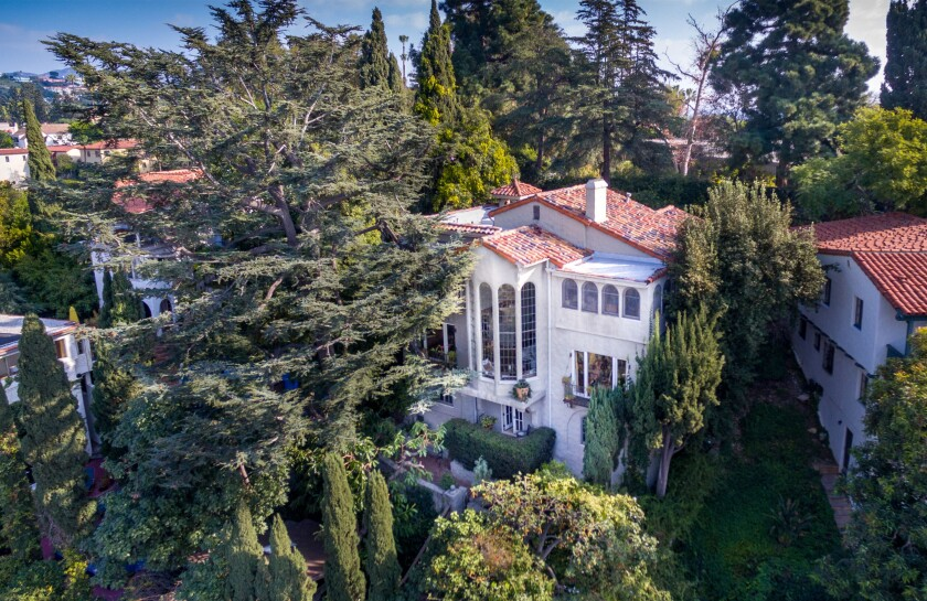 Built in 1922, the home's highlight is a series of 25-foot leaded glass windows that take in sweeping views.