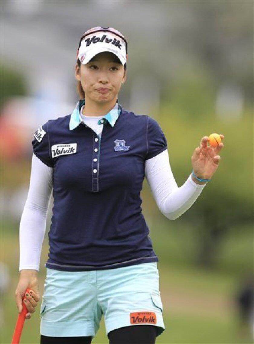 Chella Choi of South Korea acknowledges the crowd after her putt on the ninth hole during the second round of the Jamie Farr Toledo Classic golf tournament at the Highland Meadows Golf Club in Sylvania, Ohio, Friday, Aug. 10, 2012. (AP Photo/Carlos Osorio)