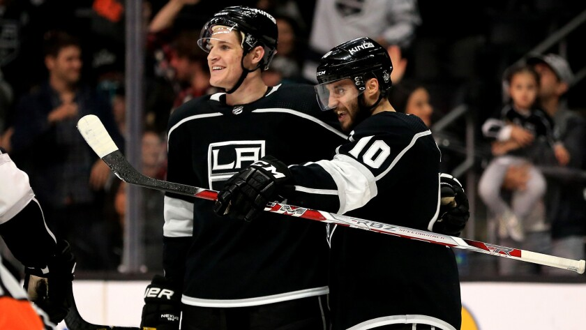 Kings defenseman Daniel Brickley, left, and teammate Tobias Rieder celebrate after Brickley earned his first NHL point (with an assist on Rieder's goal) during the second period against the Wild on Thursday.