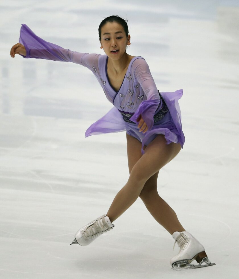 FILE - In this Saturday, Oct. 3, 2015 file photo, Mao Asada of Japan performs at the Japan Open figure skating team competition in Saitama, near Tokyo. Three-time world champion Asada will make her highly anticipated return to competitive skating at this weekend's Cup of China, the third event of t
