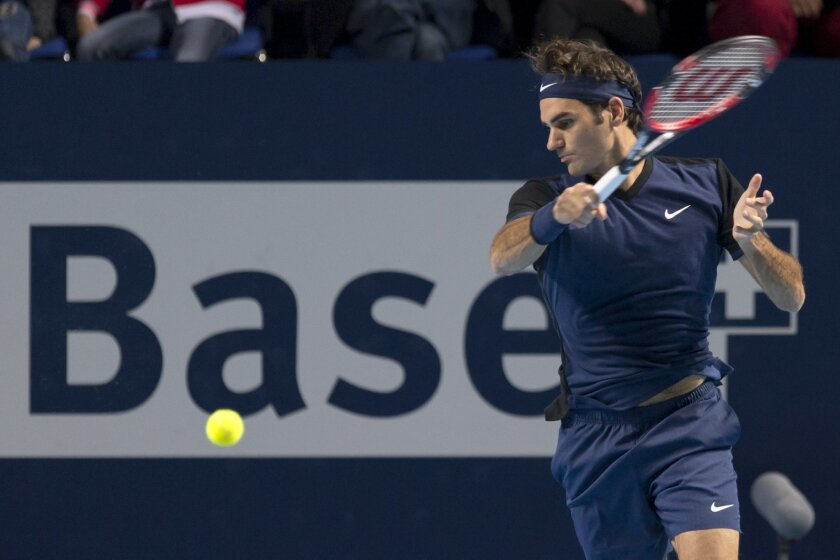 Switzerland's Roger Federer returns a ball to Spain's Rafael Nadal during their final match at the Swiss Indoors tennis tournament at the St. Jakobshalle in Basel, Switzerland, Sunday, Nov. 1, 2015. (Georgios Kefalas/Keystone via AP)