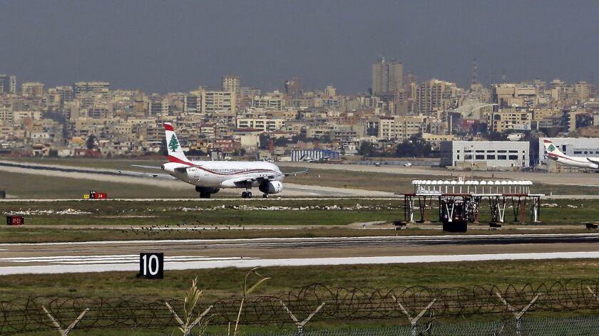 A general view shows a flock of birds (foreground) near the runway as a Middle-East airlines plane taxis at Beirut International airport in the Lebanese capital on Jan. 12, 2017.