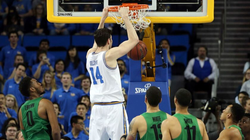 UCLA forward Gyorgy Goloman (14) dunks against Oregon during the first half.