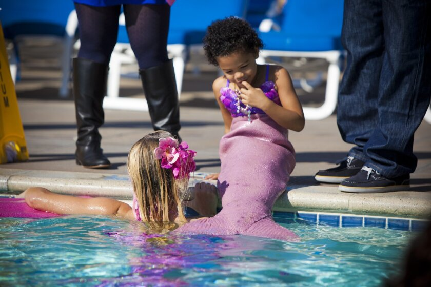 San Diego, Ca, USA, Sunday, November 03, 2013._ 5-yr-old Kaia Foster of Rancho Penasquitos has kidney cancer and the Make-a-Wish Foundation has granted her wish to become a mermaid.  Kaia tries on her mermaid outfit and prepares to swim with the mermaids.  PHOTO BY CRISSY PASCUAL/©2013 INFINITE MED