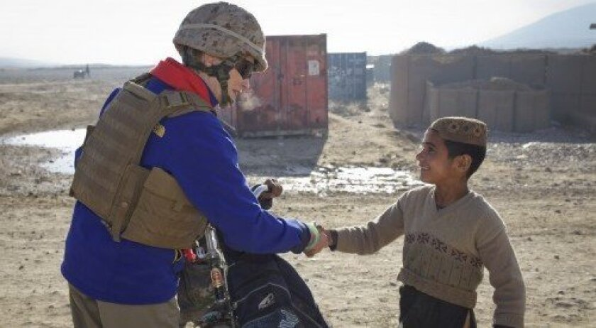 First Lady of the Marine Corps Bonnie Amos greets locals in Puzeh, Helmund Province, Afghanistan, in December 2012. U.S. Marine Corps photo by Sgt. Mallory S. Vanderschans