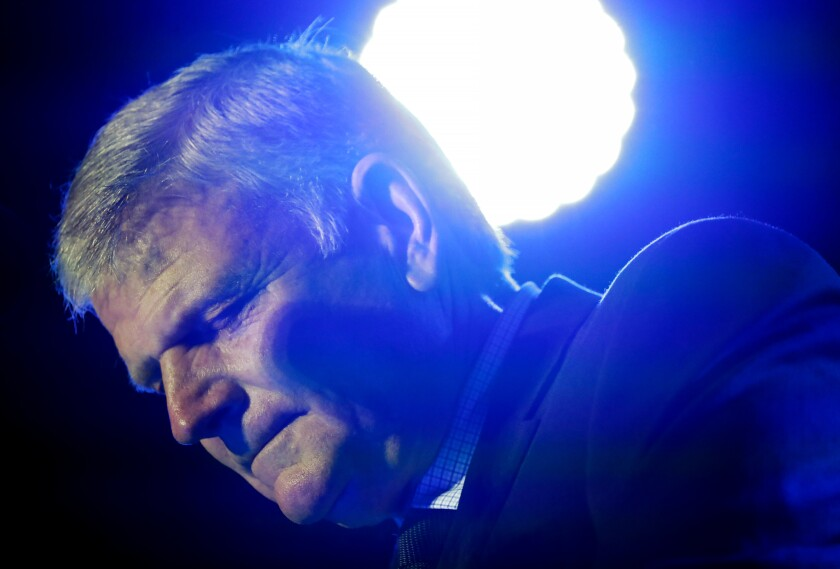 """The Rev. Franklin Graham leads the audience in prayer as he speaks at his Decision America event at the Pitt County Fairgrounds in Greenville, N.C. on Wednesday, Oct. 2, 2019. In an interview, the 67-year-old evangelist and son of the late Rev. Billy Graham said the inquiry into Trump's solicitation of help from Ukrainian leaders in investigating former Vice President Joe Biden was """"a lot over nothing."""" (AP Photo/Chris Seward)"""