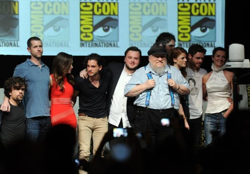 """George R.R. Martin, in suspenders, with the cast and writer-producers of """"Game of Thrones"""" at 2013's Comic-Con."""