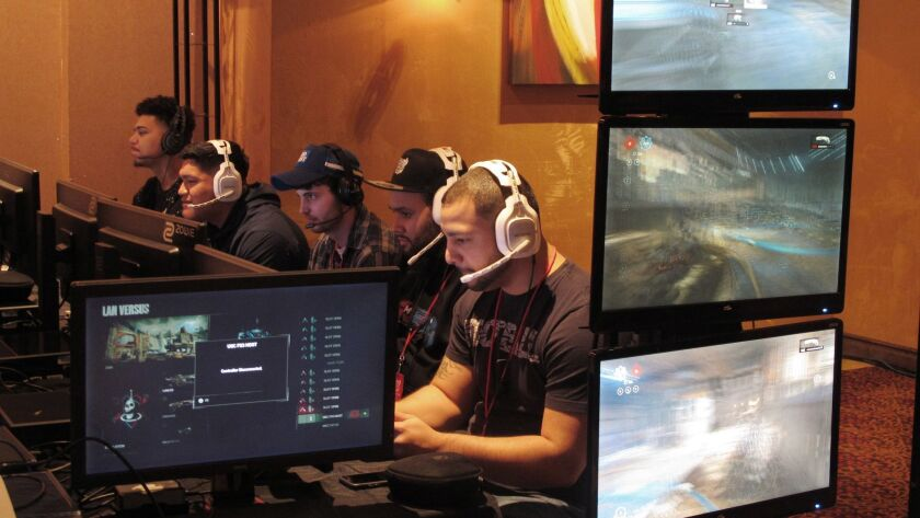 Video game players compete against one another in an esports tournament at Caesars casino in Atlantic City, N.J.