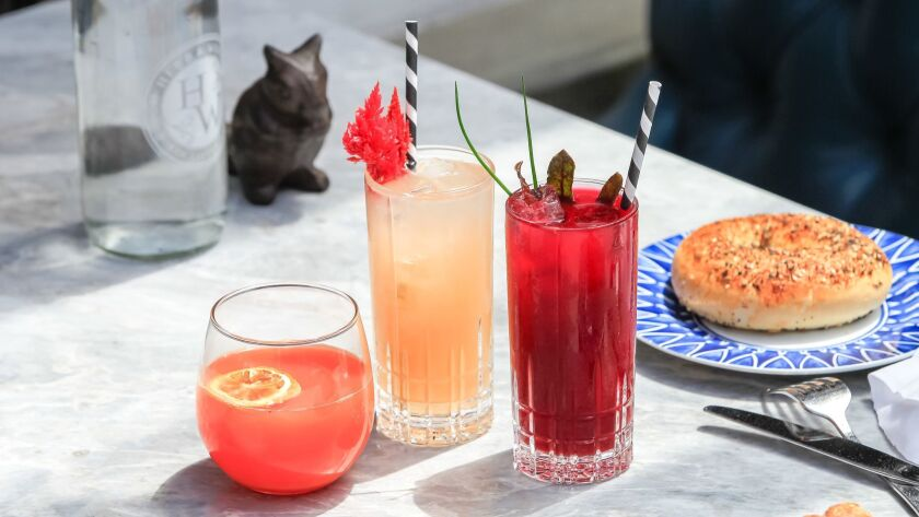 Three brunch cocktails, all from Herb & Wood: From left, Blood Orange Fennel Mimosa, Grape & Grapefruit and Beet & Gin Bloody Mary.