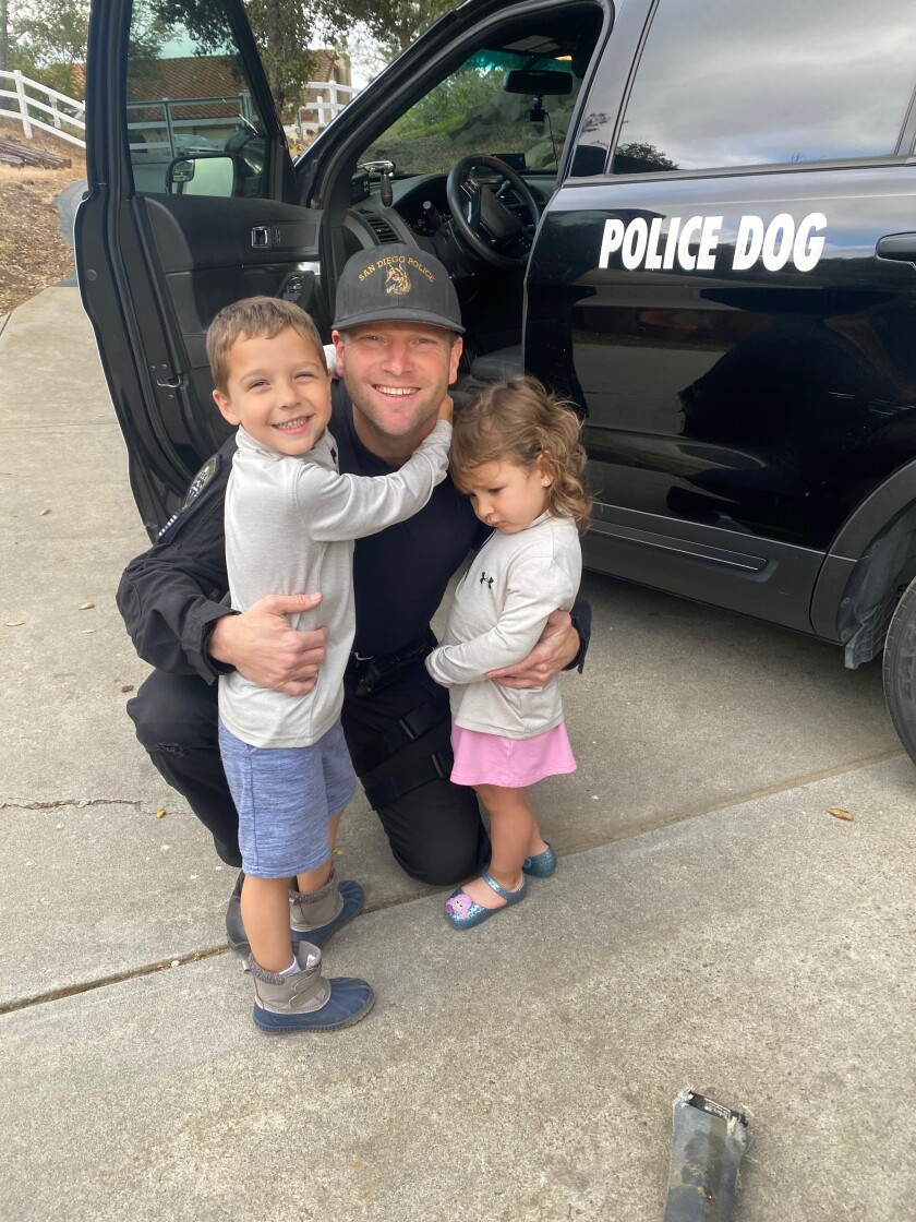 San Diego police Officer Jonathan Wiese with his two children.