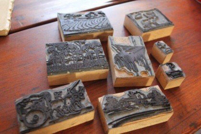 Nineteen printing press-era stamps were recently donated to the Rancho Santa Fe Historical Society. Photo/Karen Billing