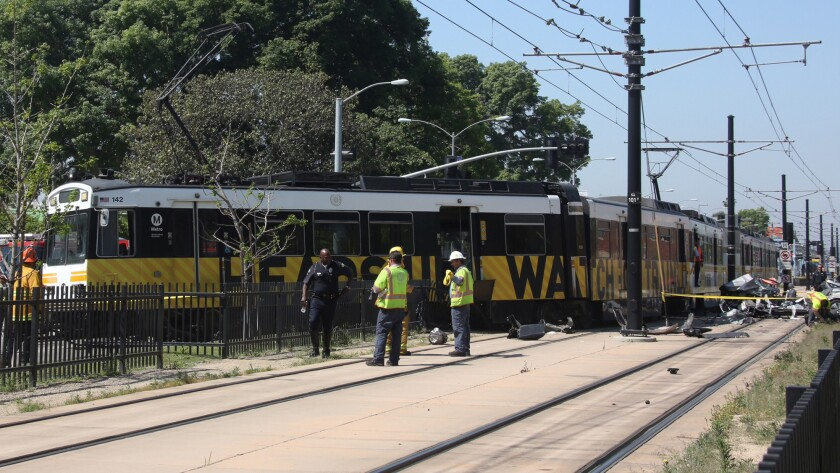 The crash derailed the Expo Line train and totaled the car. The car's driver had to be cut from the vehicle.