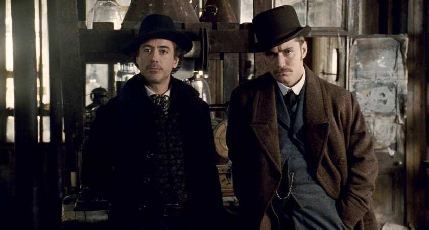 "Robert Downey Jr. and Jude Law in Warner Bros.' ""Sherlock Holmes."""