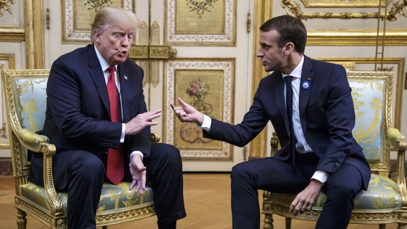 French President Emmanuel Macron and U.S President Donald J. Trump, left, meet at the Elysee palace