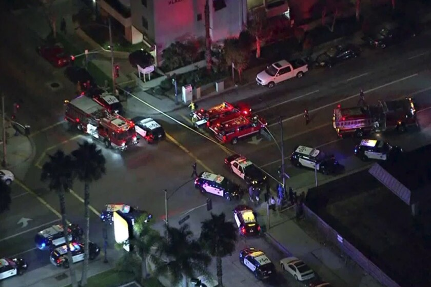 An aerial view of police at the scene of the shootings in Long Beach on Tuesday night.