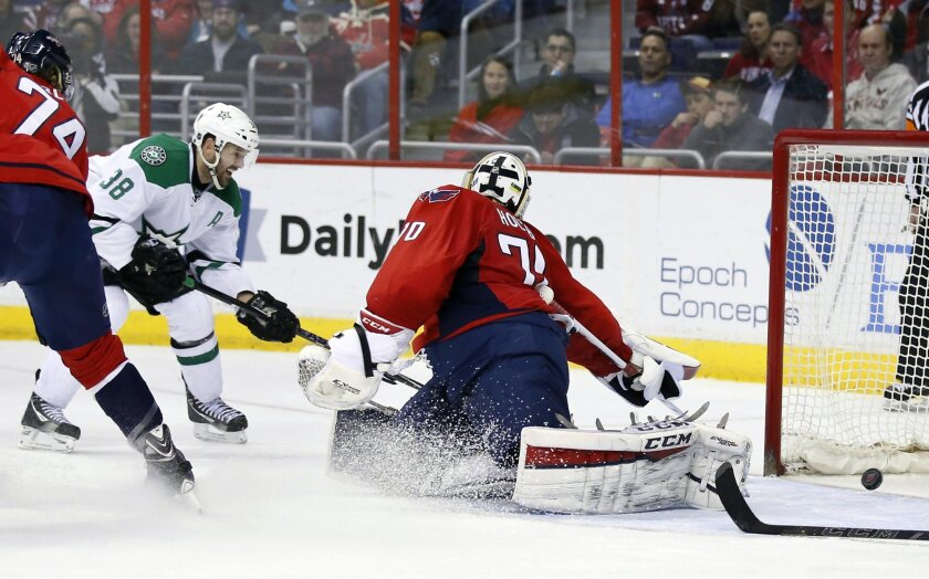 Dallas Stars center Vernon Fiddler (38) scores a goal past Washington Capitals goalie Braden Holtby (70) in the second period of an NHL hockey game, Friday, March 13, 2015, in Washington. (AP Photo/Alex Brandon)