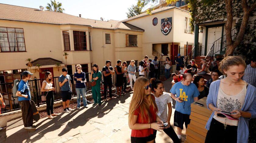 UCLA students wait in line to cast their votes at the Alpha Gamma Omega Fraternity House in Westwood.