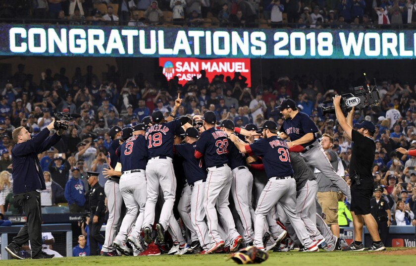 The Red Sox celebrate after defeating the Dodgers in Game 5 of the 2018 World Series.