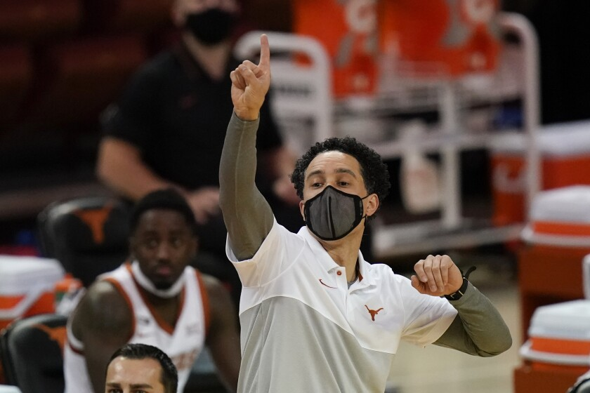 Texas head coach Shaka Smart directs his team during the first half of an NCAA college basketball game against Iowa State, Tuesday, Jan. 5, 2021, in Austin, Texas. (AP Photo/Eric Gay)