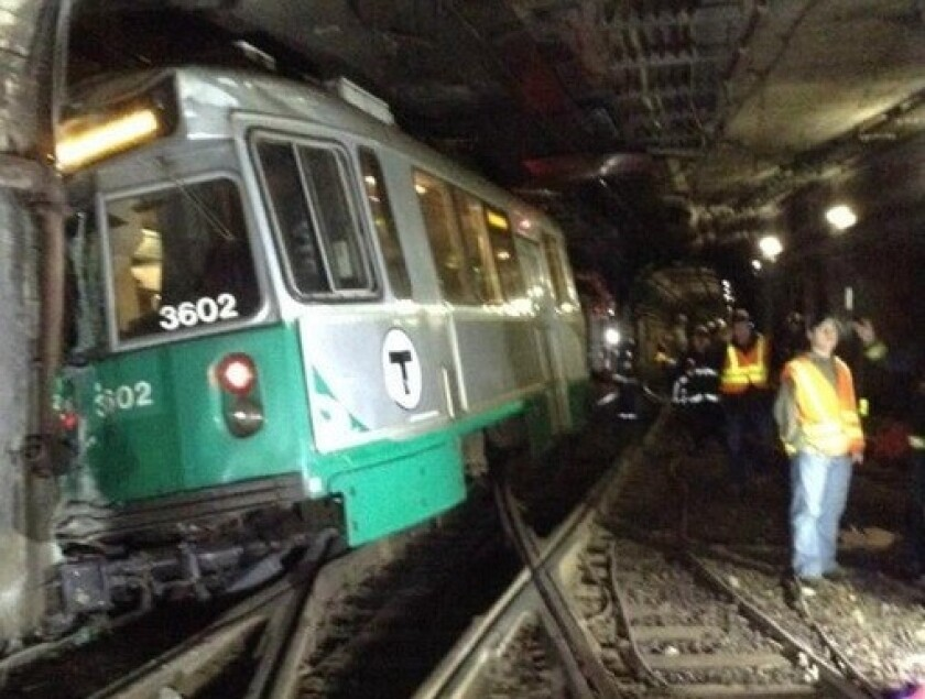 A subway train in Boston derailed underground where two tracks cross. Ten people were reported hurt, most not seriously.