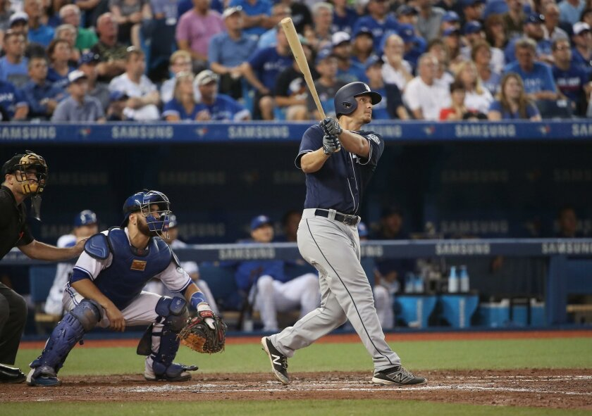 Alex Dickerson watches his three-run home run leave the park Tuesday in Toronto.